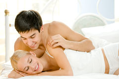 Young happy couple in bedroom Royalty Free Stock Photo