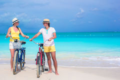 Young happy couple with bikes on summer beach vacation Stock Photography