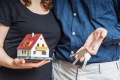 Young happy couple is buying new house.  stock images