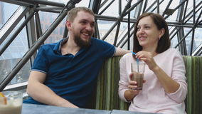 Young happy couple in cafe stock footage