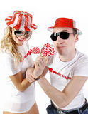 Young happy couple with candies Stock Photo