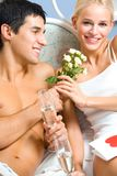 Young happy couple celebrating Royalty Free Stock Photography