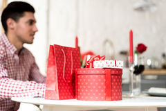 Young happy couple celebrating Valentine`s day with a dinner at home Royalty Free Stock Photography