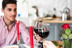 Young happy couple celebrating Valentine`s day with a toast. At home Stock Photography