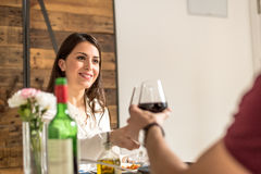 Young happy couple celebrating Valentine`s day with a toast. At home Stock Image