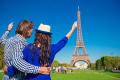Young happy couple on the Champ de Mars in Paris Royalty Free Stock Photography