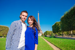 Young happy couple on the Champ de Mars in Paris Royalty Free Stock Image
