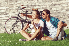Young and happy couple chilling in park. Love, relationship, rom Royalty Free Stock Photos
