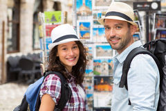 Young happy couple choosing postcards during holidays. View of Young happy couple choosing postcards during holidays Royalty Free Stock Image