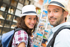 Young happy couple choosing postcards during holidays Stock Photo