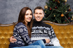 Young and happy couple on a Christmas background Royalty Free Stock Image