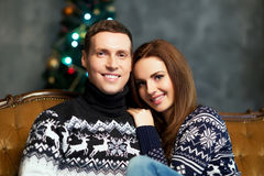 Young and happy couple on a Christmas background Royalty Free Stock Photography