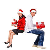 Young happy couple with a Christmas gifts. Royalty Free Stock Image