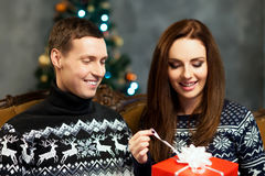 Young and happy couple with Christmas presents Royalty Free Stock Photography