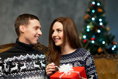 Young and happy couple with Christmas presents Royalty Free Stock Image