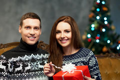 Young and happy couple with Christmas presents Stock Photography