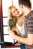 Young happy couple cooking Royalty Free Stock Photo