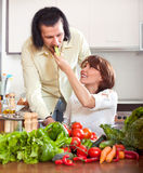 Young happy couple cooking vegetables Stock Image