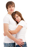 Young happy couple cuddling Stock Photos