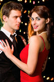 Young happy couple dancing at celebration Royalty Free Stock Photos