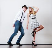 Young happy couple dancing. Young happy couple retro style dancing studio shot on gray Royalty Free Stock Photography
