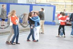 Young happy couple dancing on street Stock Image