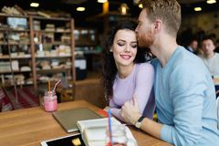 Young happy couple on date in coffee shop Stock Photography