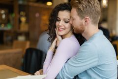 Young happy couple on date in coffee shop Stock Image