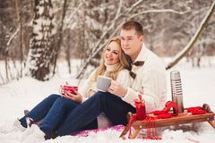Young happy couple dressed in white sweater Stock Photos