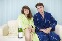 Young happy couple in dressing gowns Royalty Free Stock Images