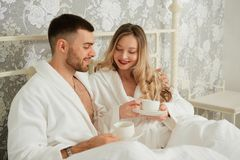 Free Young Happy Couple Drink Coffee In Luxury Hotel Room Stock Image - 160459011