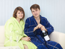 Young happy couple drinks sparkling wine Stock Photography