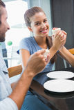 Young happy couple eating cake Royalty Free Stock Image