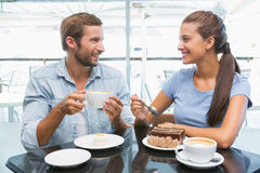 Young happy couple eating cake Royalty Free Stock Images