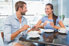 Young happy couple eating cake together Royalty Free Stock Photo