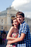 Young happy couple embracing and kissing in city Stock Image