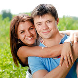 Young happy couple embracing and smiling outdoors Stock Photography