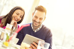 Young happy couple enjoying in coffee shop Stock Image