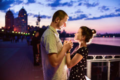Young happy couple enjoying each other in evening Stock Photo
