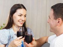 Happy couple enjoying a glasses of red wine Royalty Free Stock Photo