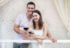 Рappy couple enjoying a glasses of red wine indoors Stock Images
