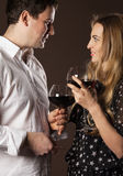 Young happy couple enjoying a glasses of wine Royalty Free Stock Photos