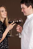 Young happy couple enjoying a glasses of wine Royalty Free Stock Photo