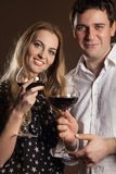 Young happy couple enjoying a glasses of wine Stock Photo