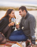 Young happy couple enjoying picnic on the beach. Together Stock Photo