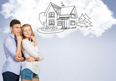 Young happy couple. Young happy family couple dreaming of future wealthy life Stock Images