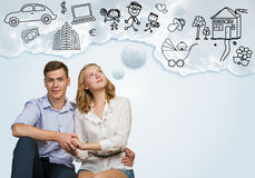 Young happy couple. Young happy family couple dreaming of future wealthy life Royalty Free Stock Images