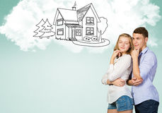 Young happy couple. Young happy family couple dreaming of future wealthy life Royalty Free Stock Photo