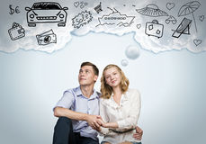 Young happy couple. Young happy family couple dreaming of future wealthy life Royalty Free Stock Image