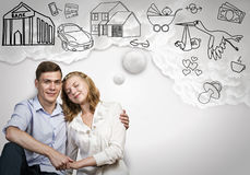 Young happy couple. Young happy family couple dreaming of future wealthy life Stock Photography